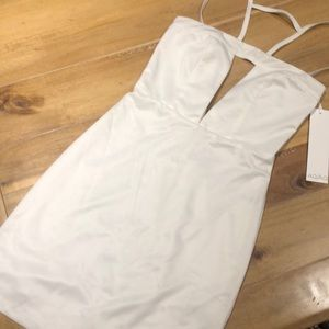 White dress fitted w/ cutout